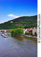 Embankment of Neckar river and ship in Heidelberg Germany -...