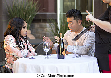 Embarrassed Boyfriend Trying To Calm Angry Girlfriend in Restaurant