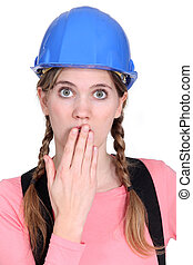 Embarrassed female builder