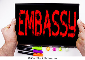 Embassy text written on tablet, computer in the office with marker, pen, stationery. Business concept for Tourist Visa Application white background with copy space