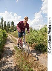 ember, képben látható, bicikli