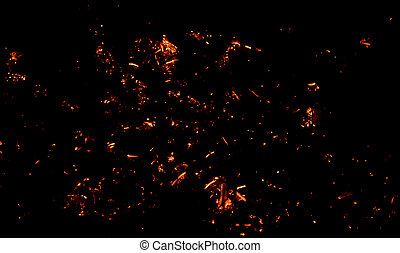 Embers on black. Abstract background.