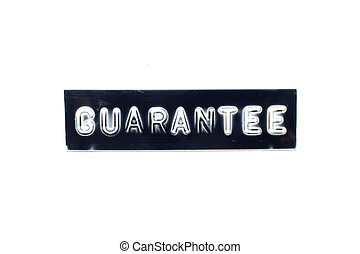 Embossed letter in word guarantee on black banner with white background