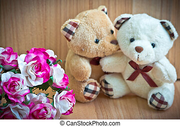 Embrace Bears in love, sit near bouquet rose