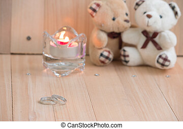 Embrace Bears in love, sit near Engagement ring and Candlestick