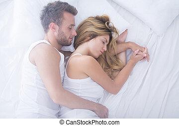 Embraced couple sleeping