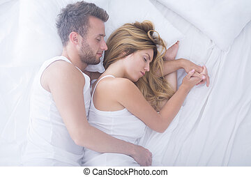 Embraced couple sleeping