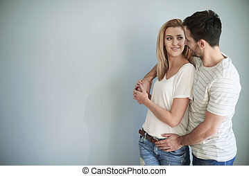 Embraced couple with big copy space