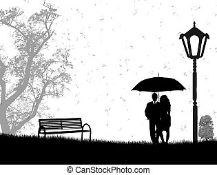 Embraced lovers - Lovers in a park under a rain, on black...