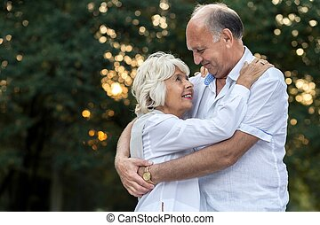 Embraced senior couple