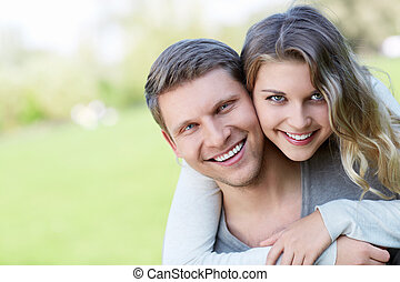 Embraces couple - Happy young couple outdoors