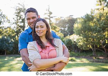 Embracing couple outside
