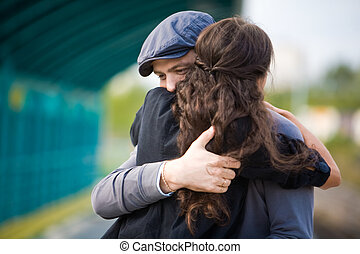 Embracing couple - Photo of pretty girl and her boyfriend...