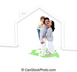 Embracing family standing with a house illustration