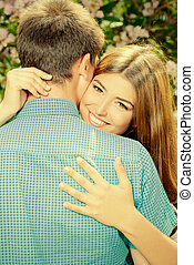 embracing tenderly - Beautiful young couple in love in a...