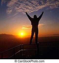 embracing the sun - sunset or sunrise as a embraces the sun...