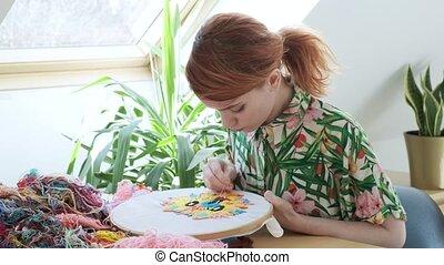 embroidery hoop, fabric with image. Needlework, handicraft. ...