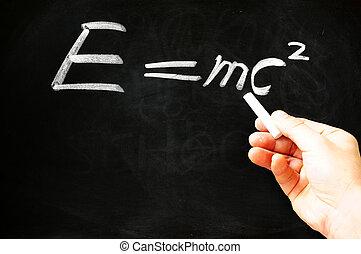 E=mc? Albert Einsteins physical formula on blackboard -...