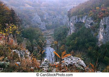Emen canyon near the city of Veliko Tarnovo in Bulgaria on a raw foggy morning in the fall