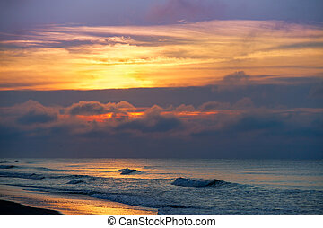 A glorious, coloful sunrise sky over the Atlantic Ocean is seen at Emerald Isle, North Carolina.