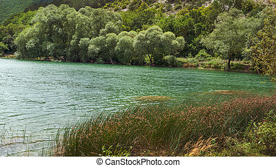 emerald water of mountain lake