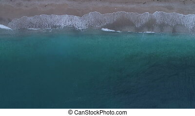 emerald waves on the beach view from above