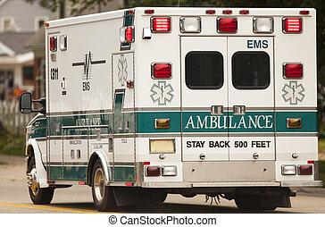 Emergency Ambulance - Emergency ambulance with lights on.