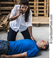 emergency call - rescuer call emergency number for an ...