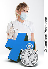 Emergency dental care - Female dentist holding a syringe, a...