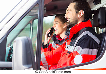 Emergency doctor driving in ambulance