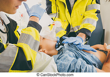 Emergency doctor giving cardiac massage for reanimation in ambul