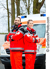 Emergency doctor in front of ambulance car