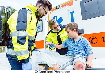 Emergency doctors caring for accident victim boy