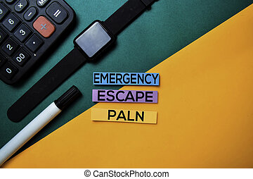 Emergency Escape Plan text on top view color table background.