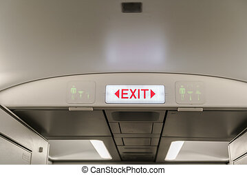 Emergency exit in aircraft ( Filtered image processed vintage effect. ) .