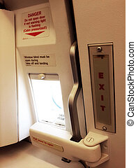 Emergency exit in the aircraft, text in English