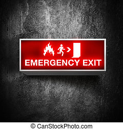Emergency exit sign - Fire emergency exit sign on a grunge ...