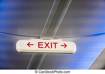 Emergency Exit Sign inside a plane