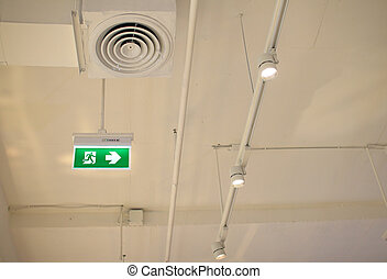 Emergency exit sign showing the way to escape in departments