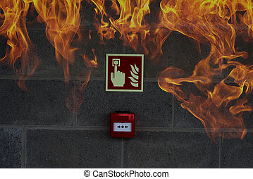 Emergency Fire Exit on the stone wall with fire flames