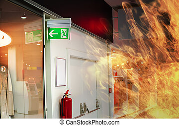 Emergency fire exit sign and fire in shopping mall.