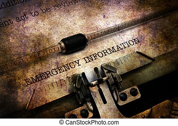 Emergency information text on typewriter