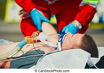 Emergency medical service - Paramedic preparing the patient...