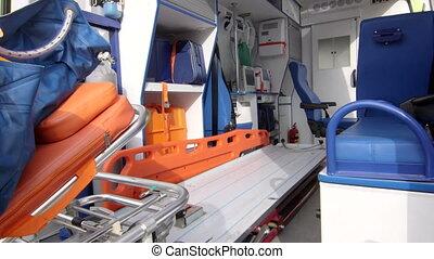 Emergency medical service paramedics load senior patient into ambulance