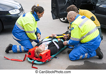 Emergency medical services - Paramedics and a fireman...