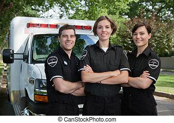 Emergency Medical Team Portrait - Group of three paramedics...