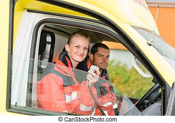 Emergency paramedic in ambulance car talk radio smiling...