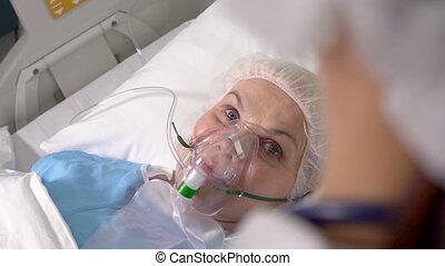 Emergency patient - An emergency patient wearing an oxygen...