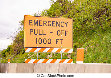 Emergency pull off 1000ft text, Warning road sign, highway in United states
