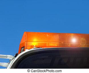 Emergency response - Flashing yellow light tops an emergency...